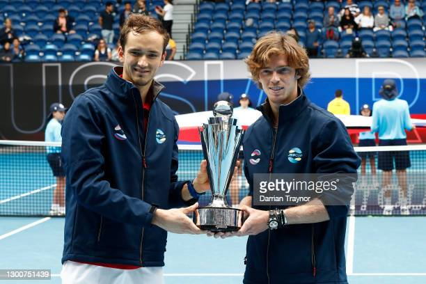 Daniil Medvedev of Russia and Andrey Rublev of Russia pose with the ATP Cup Trophy after defeating Italy in the Final during day six of the 2021 ATP...