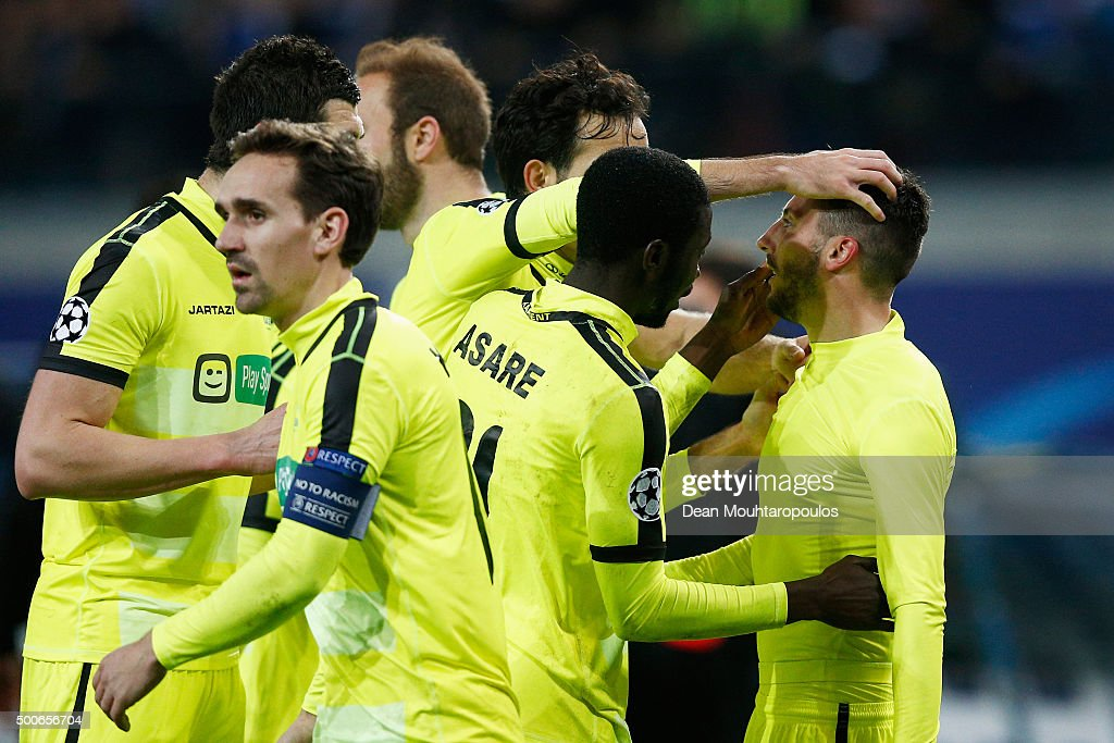 Danijel Milicevic (R) of Gent celebrates scoring his teams second goal of the game with team mates during the group H UEFA Champions League match between KAA Gent and Football Club Zenit Saint Petersburg held at Ghelamco Arena, on December 9, 2015 in Gent, Belgium.