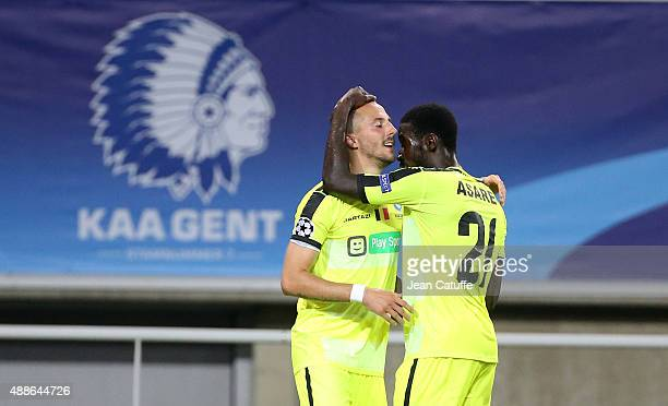 Danijel Milicevic of KAA Gent celebrates his goal with teammate Nana Asare during the UEFA Champions League match between KAA Ghent and Olympique...
