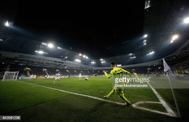 Danijel Milicevic of KAA Gent takes a corner during the UEFA Europa League Round of 32 first leg match between KAA Gent and Tottenham Hotspur at...