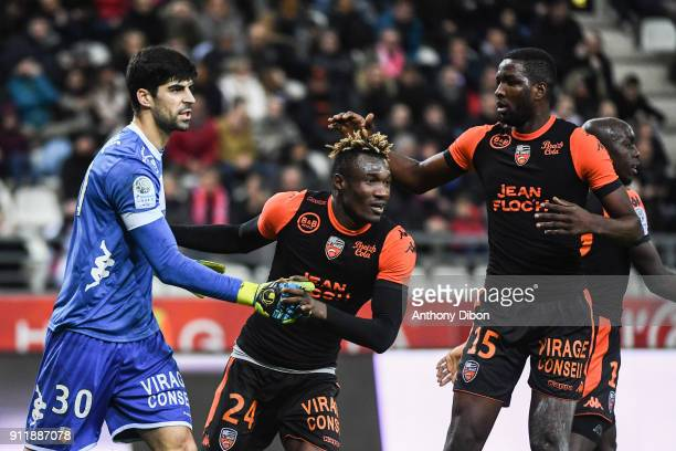 Danijel Petkovic goalkeeper of Lorient is congratulates by his team mates Franklin Wadja and Ibrhaima Conte of Lorient during the Ligue 2 match...