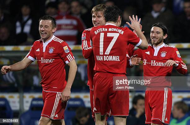 Danijel Pranjic of Bayern celebrates with his team mates Ivica Olic Mark van Bommel and Holger Badstuber after scoring his team's fourth goal during...