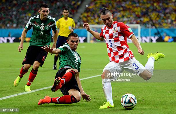 Danijel Pranjic of Croatia controls the ball as Paul Aguilar of Mexico gives chase during the 2014 FIFA World Cup Brazil Group A match between...