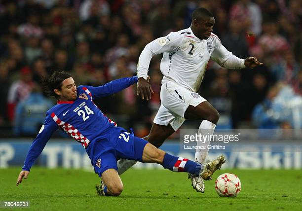 Danijel Pranjic of Croatia makes a tackle on Micah Richards of England during the Euro 2008 Group E qualifying match between England and Croatia at...