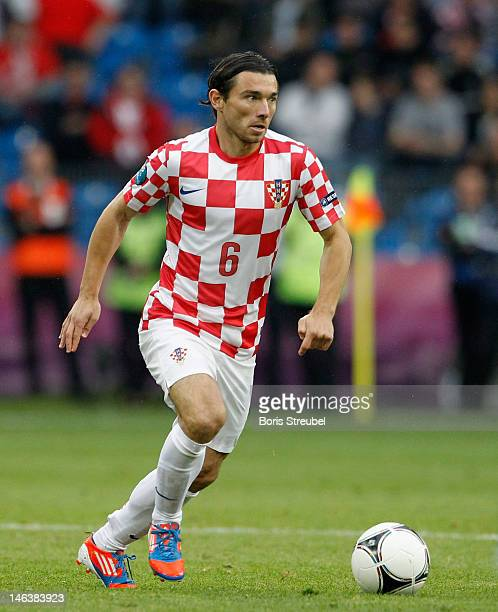 Danijel Pranjic of Croatia runs with the ball during the UEFA EURO 2012 group C match between Italy and Croatia at The Municipal Stadium on June 14...