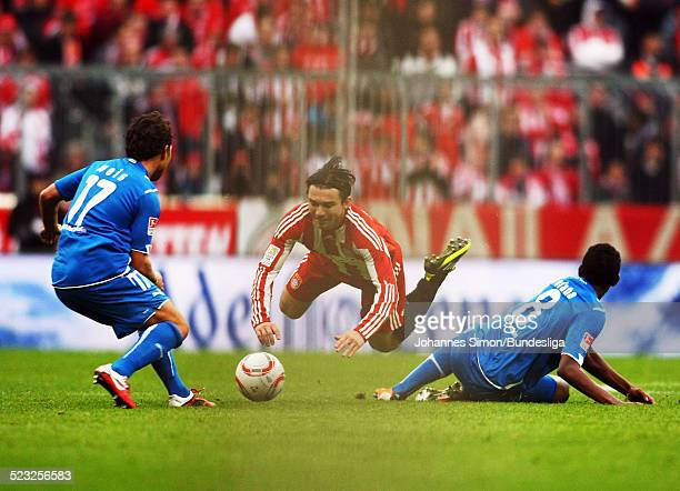Danijel Pranjic of Muenchen and Tobias Weis and David Alaba fight for the ball during the Bundesliga match between FC Bayern Muenchen and 1899...