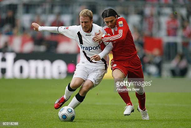 Danijel Pranjic of Muenchen fights for the ball with Patrick Ochs of Frankfurt during the Bundesliga match between Bayern Muenchen and Eintracht...