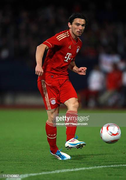 Danijel Pranjic of Muenchen runs with the ball during the friendly match between FC Bayern Muenchen and Team Paulaner at Wacker Arena on May 16 2011...