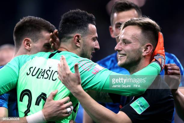 Danijel Subasic and Ivan Rakitic of Croatia celebrate their victory following the 2018 FIFA World Cup Russia Round of 16 match between Croatia and...