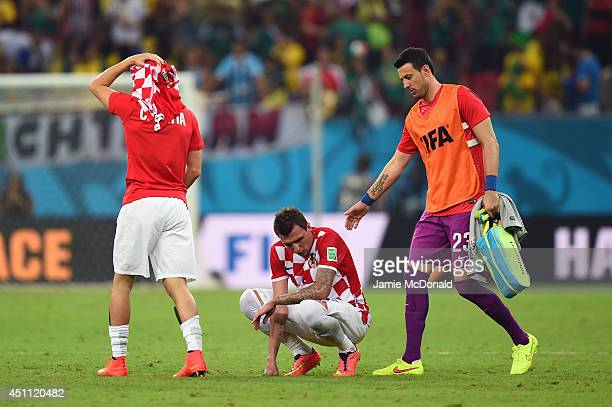 Danijel Subasic consoles Mario Mandzukic of Croatia after a 31 defeat in the 2014 FIFA World Cup Brazil Group A match between Croatia and Mexico at...