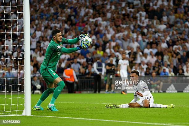 Danijel Subasic of AS Monaco saves from Dele Alli of Tottenham Hotspur during the UEFA Champions League match between Tottenham Hotspur FC and AS...