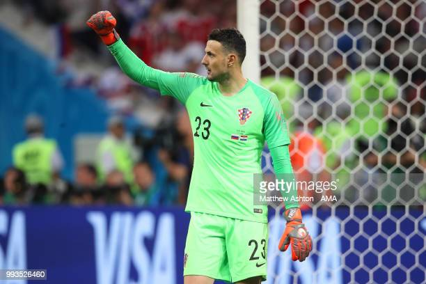 Danijel Subasic of Croatia celebrates after Mario Fernandes of Russia put his penalty wide in a penalty shootout during the 2018 FIFA World Cup...