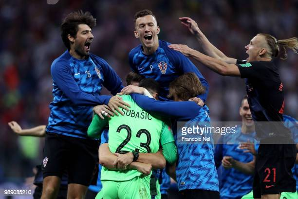 Danijel Subasic of Croatia celebrates his side's victory with team mates following the 2018 FIFA World Cup Russia Round of 16 match between Croatia...