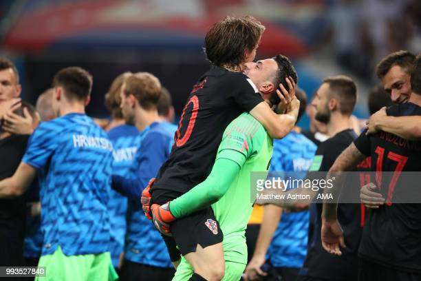 Danijel Subasic of Croatia celebrates with Luka Modric of Croatia after their victory in a penalty shootout during the 2018 FIFA World Cup Russia...