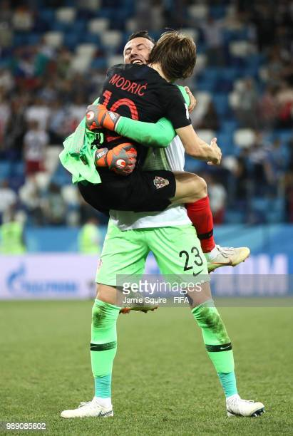 Danijel Subasic of Croatia celebrates with teammate Luka Modric following his sides victory in a penalty shoot out during the 2018 FIFA World Cup...