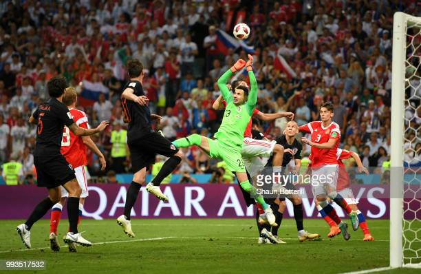 Danijel Subasic of Croatia is fouled by Aleksandr Erokhin of Russia during the 2018 FIFA World Cup Russia Quarter Final match between Russia and...