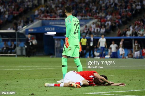 Danijel Subasic of Croatia looks on while Aleksandr Erokhin of Russia lies on the pitch injured during the 2018 FIFA World Cup Russia Quarter Final...
