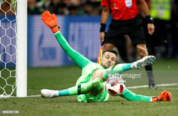 Danijel Subasic of Croatia saves Denmark's fifth penalty taken by Nicolai Jorgensen during penalty shoot out following the 2018 FIFA World Cup Russia...