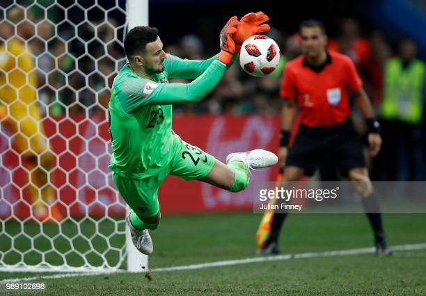 Danijel Subasic of Croatia saves Denmark's fourth penalty taken by Lasse Schone during penalty shoot out following the 2018 FIFA World Cup Russia...