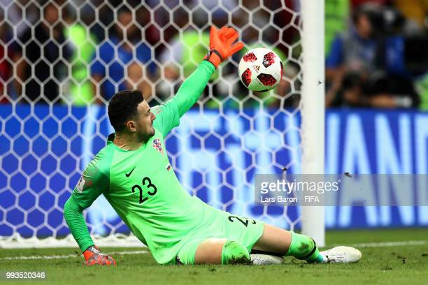 Danijel Subasic of Croatia saves the first penalty from Fedor Smolov of Russia in the penalty shoot out during the 2018 FIFA World Cup Russia Quarter...