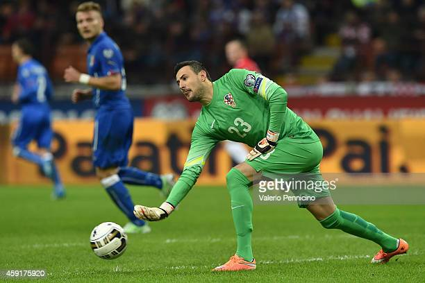 Danijel Subasic of Croatia throws the ball during the EURO 2016 Group H Qualifier match between Italy and Croatia at Stadio Giuseppe Meazza on...