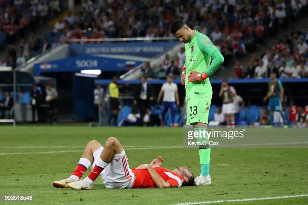 Danijel Subasic of Croatia watches Aleksandr Erokhin of Russia liying on the pitch injured during the 2018 FIFA World Cup Russia Quarter Final match...