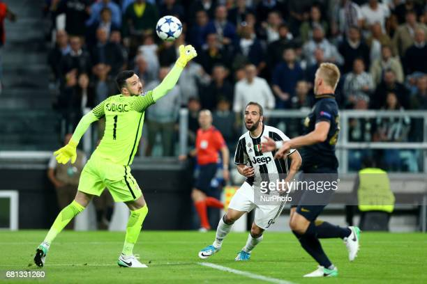 Danijel Subasic of Monaco saving on Gonzalo Higuain of Juventus at Juventus Stadium in Turin Italy on May 9 2017