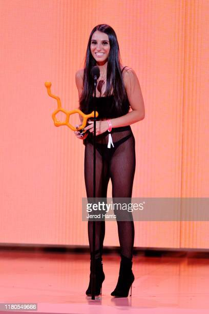 Danika Mori accepts award on stage at the 2nd Annual Porn Hub Awards at The Orpheum Theatre on October 11 2019 in Los Angeles California