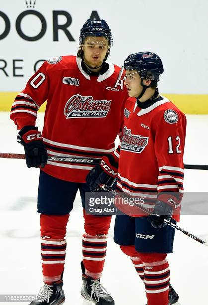 Danil Antropov and Lleyton Moore of the Oshawa Generals skate against the Mississauga Steelheads during game action on October 25 2019 at Paramount...