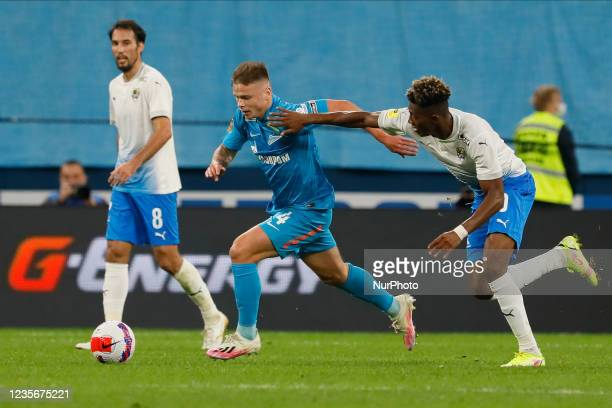Danil Krugovoy of Zenit and Mateo Cassierra of Sochi vie for the ball during the Russian Premier League match between FC Zenit Saint Petersburg and...