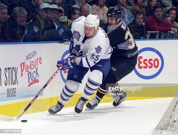 Danil Markov of the Toronto Maple Leafs skates agains Kip Miller of the Pittsburgh Penguins during the 1999 Quarter Finals of the NHL playoff game...