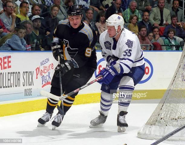 Danil Markov of the Toronto Maple Leafs skates against German Titov of the Pittsburgh Penguins during the 1999 Quarter Finals of the NHL playoff game...