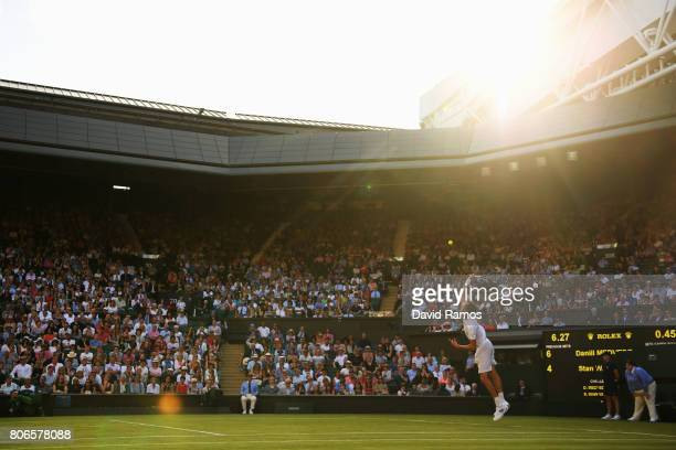 Danil Medvedev of Russia serves during the Gentlemen's Singles first round match against Stan Wawrinka of Switzerland on day one of the Wimbledon...