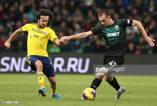 Danil Utkin of FC Krasnodar vies for the ball with Khoren Bayramyan of FC Rostov Rostov-on-Don during the Russian Premier League match between FC...