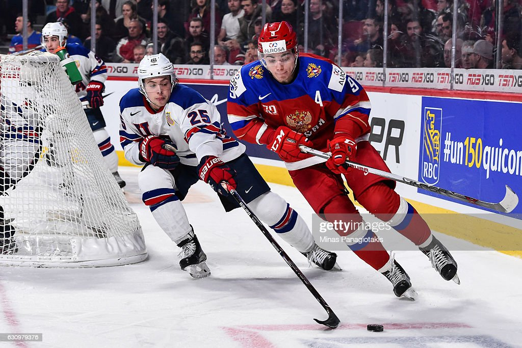 Danila Kvartalnov #9 of Team Russia skates the puck against Charlie McAvoy #25 of Team United States during the 2017 IIHF World Junior Championship semifinal game at the Bell Centre on January 4, 2017 in Montreal, Quebec, Canada.
