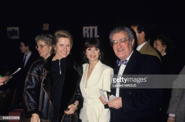 Danièle Gilbert, Danièle Evenou et l'ancien ministre Georges Fillioud lors du passage de l'humoriste Patrick Sébastien à l'Olympia le 4 janvier 1987...