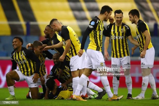 Danilho Doekhi of Vitesse Arnhem celebrates scoring his teams first goal of the game with team mates during the Dutch Eredivisie match between...