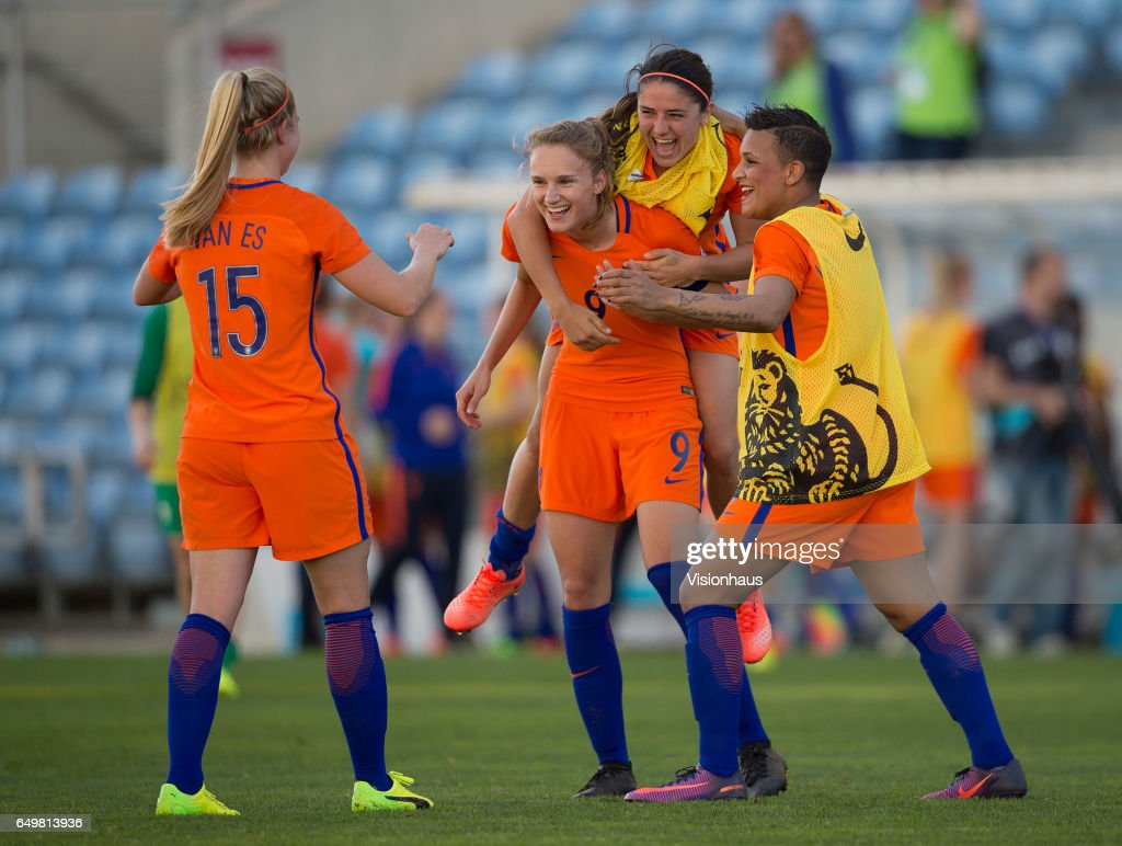 Daniëlle van de Donk jumps on the back of Vivianne Miedema as they and Kika van Es and Shanice van de Sanden celebrate winning the Fifth Place Playoff in the 2017 Algarve Cup match between Japan and The Netherlands at the Estadio Algarve on March 08, 2017 in Faro, Portugal.