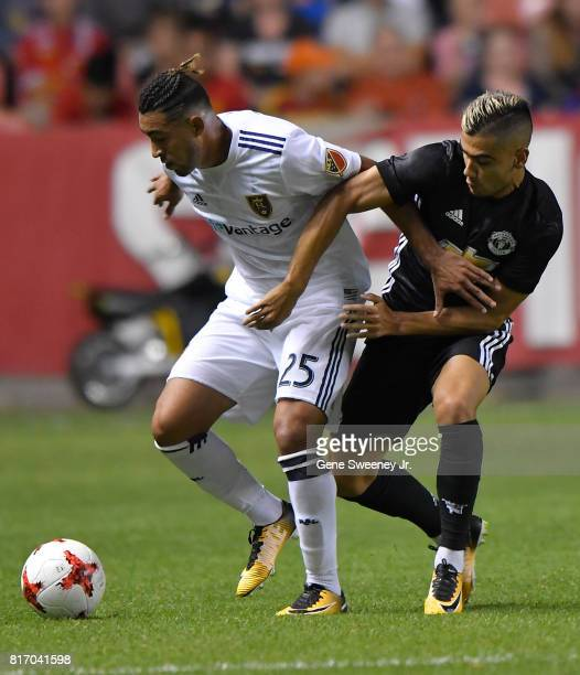 Danilo Acosta of Real Salt Lake fights for the ball with Andreas Pereira of Manchester United during the second half of the International friendly...