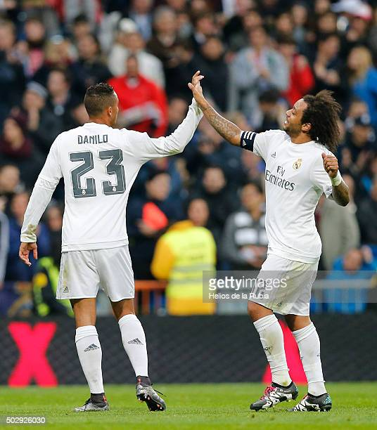 Danilo and Marcelo of Real Madrid celebrate after scoring during the La Liga match between Real Madrid CF and Real Sociedad at Estadio Santiago...