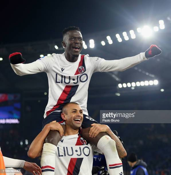 Danilo and Musa Barrow of Bologna FC celebrate the victory after the Serie A match between AS Roma and Bologna FC at Stadio Olimpico on February 7...