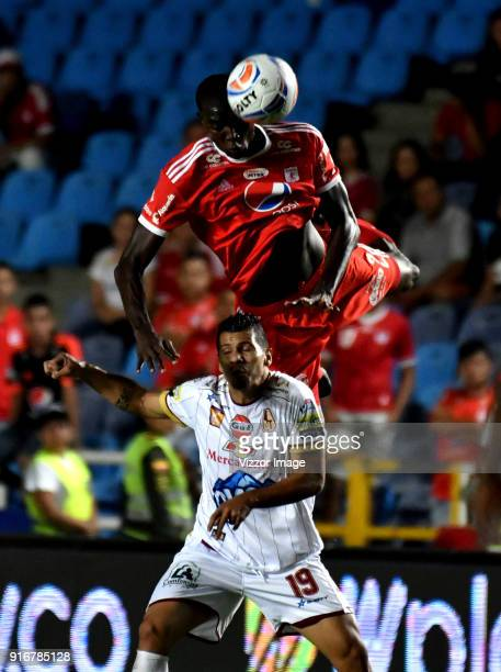 Danilo Arboleda of of America jumps for the ball with Robin Ramirez of Deportes Tolima during a match between America de Cali and Deportes Tolima as...