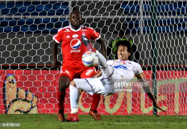 Danilo Arboleda of of America vies for the ball with Rafael Robayo of Deportes Tolima during a match between America de Cali and Deportes Tolima as...