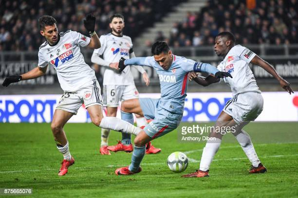 Danilo Avelar of Amiens and Radamel Falcao of Monaco during the Ligue 1 match between Amiens SC and AS Monaco at Stade de la Licorne on November 17...
