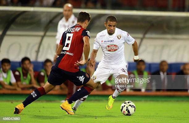 Danilo Avelar of Cagliari and Bruno Peres of Torino comepte for the ball during the Serie A match between Cagliari Calcio and Torino FC at Stadio...