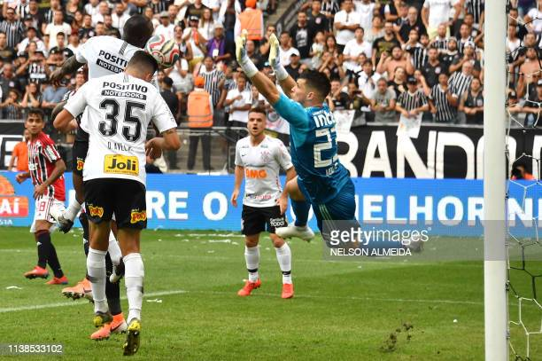 Danilo Avelar of Corinthians heads the ball to score against Sao Paulo during the Paulista championship final football match held at the Arena...