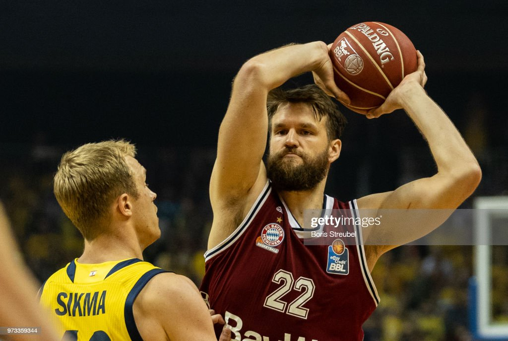 Danilo Barthel of Bayern Muenchen competes with Luke Sikma of ALBA Berlin during the fourth play-off game of the German Basketball Bundesliga finals at Mercedes-Benz Arena on June 13, 2018 in Berlin, Germany.