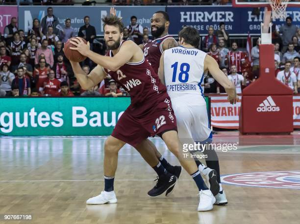 Danilo Barthel of Muenchen Reggie Redding of Muenchen and Evgeny Voronov of St Petersburg battle for the ball during the EuroCup Top 16 Round 3 match...