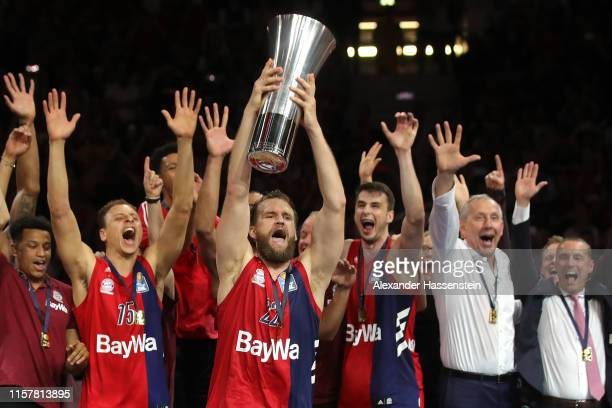 Danilo Barthels of Muenchen lifts the winners trophy in celebration of the German Championship title after winning game three of the easycredit...