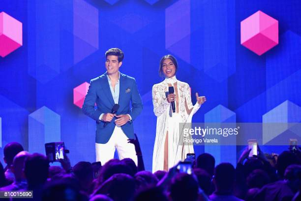 Danilo Carrera and Alejandra Espinoza speak on stage at the Univision's 'Premios Juventud' 2017 Celebrates The Hottest Musical Artists And Young...